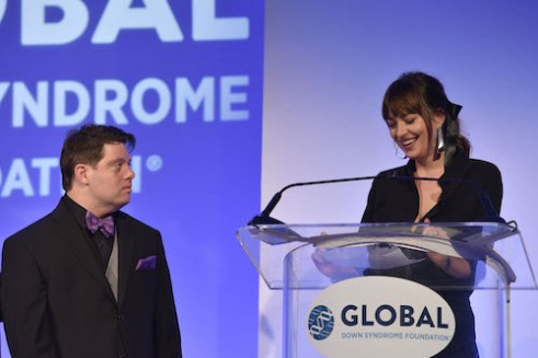 Zack Gottsagen with Dakota Johnson at the Global Down Syndrome 10th anniversary BBBY fashion show at Sheraton Denver Downtown Hotel on October 20, 2018 in Denver, Colorado. (Photo by Tom Cooper/Getty Images for Global Down Syndrome Foundation)