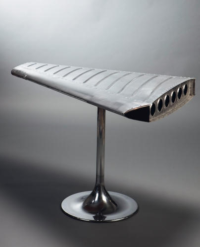 A plane's tail unit is now a glossy polished table. Photo © Style Classics; www.styleclassics.de